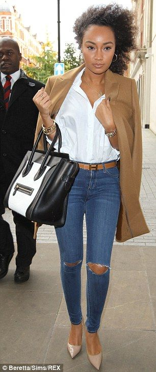 Leigh-Anne Pinnock looks very chic and smart by draping an elegant camel coat over her shoulders teamed with a crisp white shirt, knee slashed jeans and matching Hermes tan belt and tan pumps - plus we still love that monochrome Celine bag...x