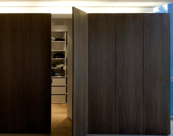 Hidden door inside a custom made cupboard by holzrausch for Hidden door ideas