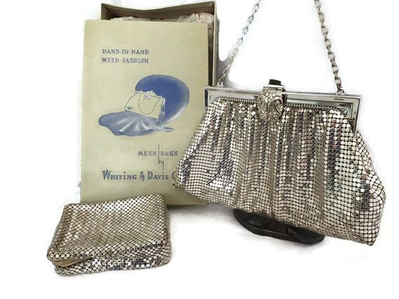 This is a beautiful vintage Whiting and Davis silver mesh purse and matching case. It is in very good condition and measures 7 wide x 4 3/4 high. The