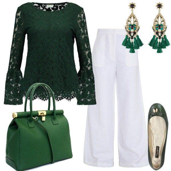 Una blusa in pizzo, a maniche lunghe, in una profonda tonalità di verde scuro, viene indossata con un paio di pantaloni bianchi, ampi. Le scarpe sono delle ballerine con fiocchetto dorato e anche la borsa a mano h dettagli dorati. Un paio di orecchini con pendenti verdi completa il tutto.