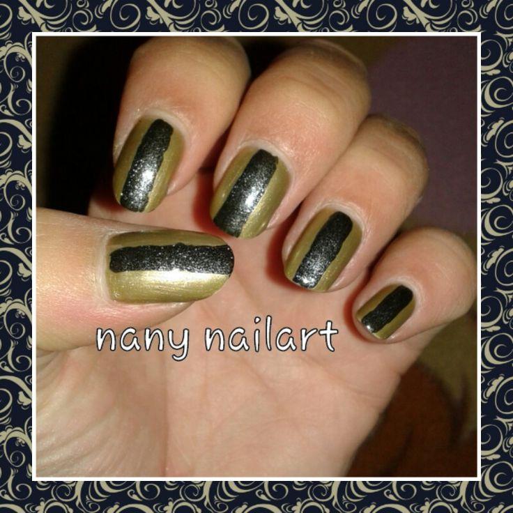 Gold and black nails polish