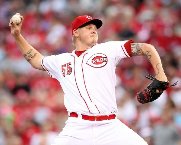 Mat Latos #55 of the Cincinnati Reds throws a pitch during the game against the Atlanta Braves at Great American Ball Park #MLB #Reds #Baseball - http://www.fansedge.com/Mat-Latos-Cincinnati-Reds-5222012-_1988711849_PD.html?social=pinterest_mlb_52412_latos