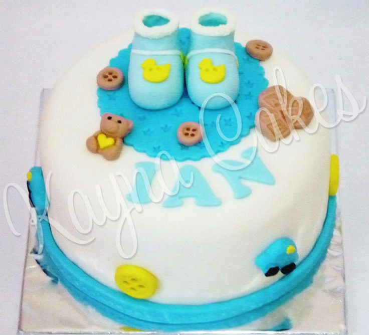 Baby Ian's manyue cake. Baby shoes.