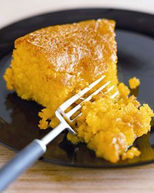 """Fresh lemon juice gives this fluffy polenta cake from Nigella Lawson's """"Nigella Kitchen"""" cookbook its light, tangy flavor.      Photo credit: Lis Parsons"""