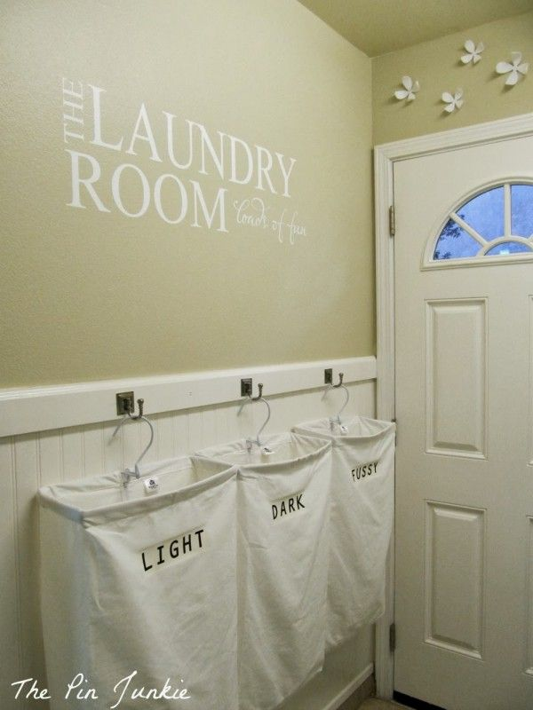 Laundry Room Makeover with Personalized Hanging Laundry Bags, The Pin Junkie featured on Remodelaholic.com #laundryroom #organize #smallspac...