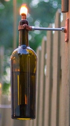 Wine Bottle Tiki torch -great garden idea .....