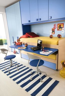 Interesting use of space, although I can see kids breaking those work surfaces right off; plus, it looks you'd have to clean everything off to get into bed.