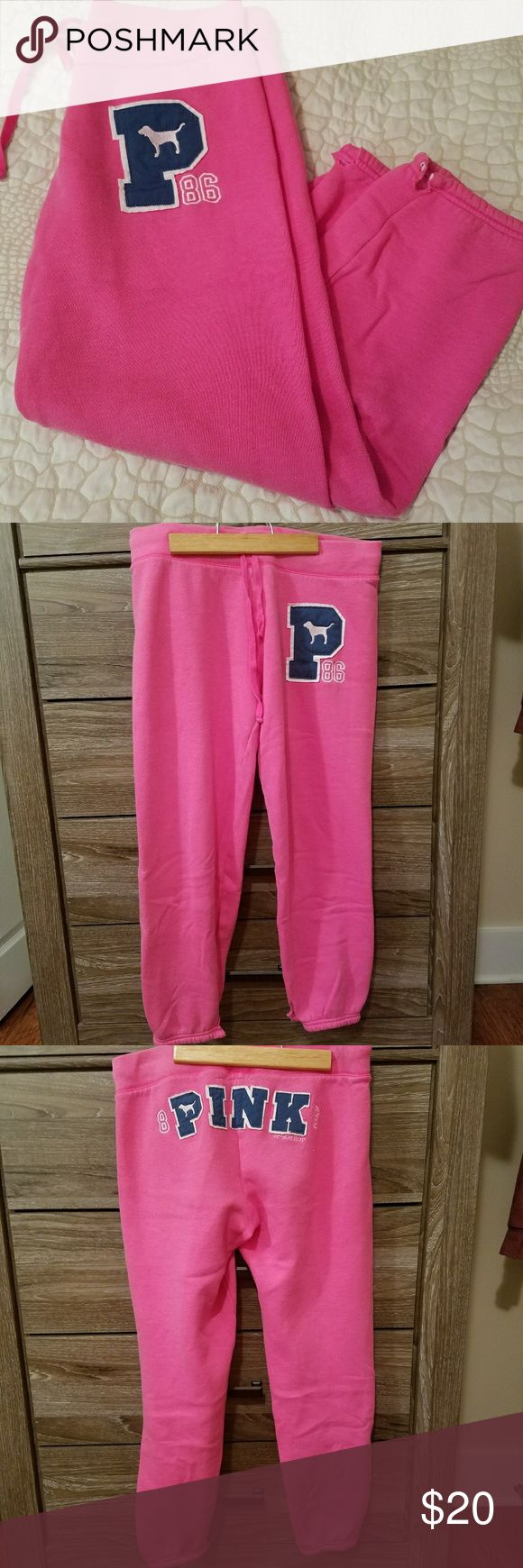 Victoria's Secret PINK capri pants Classic pink boyfriend style sweatpants with dark blue lettering. Size small. Lightly used and great condition. Drawstring at waist.  Very comfortable! Victoria's Secret Pants Capris