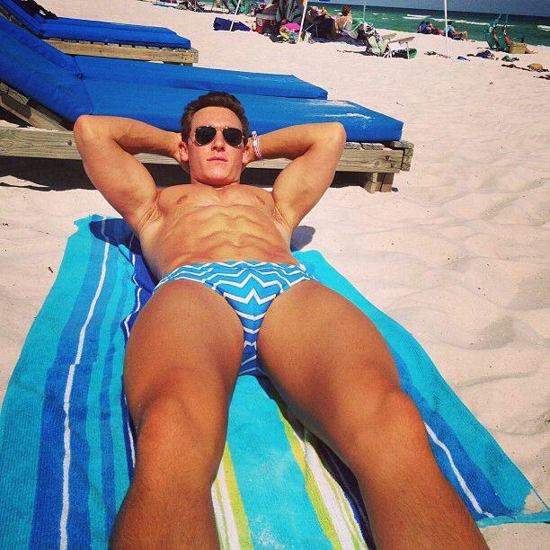 Beach boy sunbathing in blue speedo | Beach Boys ...
