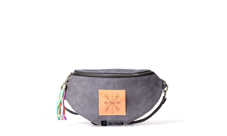 Waist bag is made of the best quality natural leather (nubuck). Inside:  pocket for mobile,  lining.  Fastening ended with decorative tassel/pendant. Accessories in antique gold color. Color- grey.