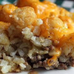 This hamburger tater tot casserole recipe has a layer of ground beef in a homemade cream sauce, topped with crispy baked tater tots and melted cheddar cheese! A full meal in itself.