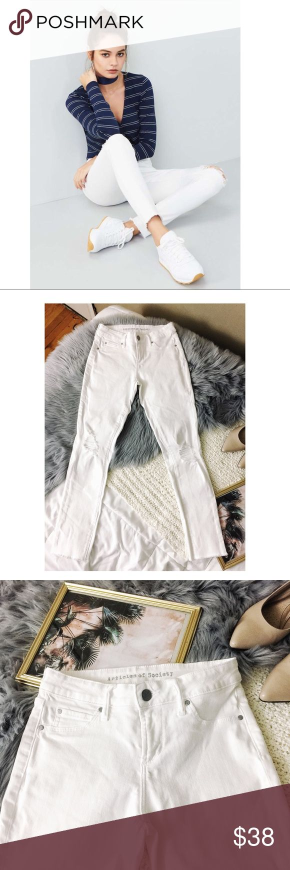 """Articles of Society White Distressed Skinny Jeans Articles of society Sarah white Distressed Skinny Jeans Size 24 Condition: no known flaws or stains   Features  Raw hems and roughed-up patches belie the fresh, clean appeal of bright-white super-skinny jeans cut from a stretchy cotton-blend denim. Zip fly with button closure Faux front pockets; coin pocket; back pockets 80% cotton, 18% rayon, 2% spandex  Approximate measurements  Length 35.5""""  Inseam 26.5"""" Rise 8"""" Waist 13"""" across Articles…"""
