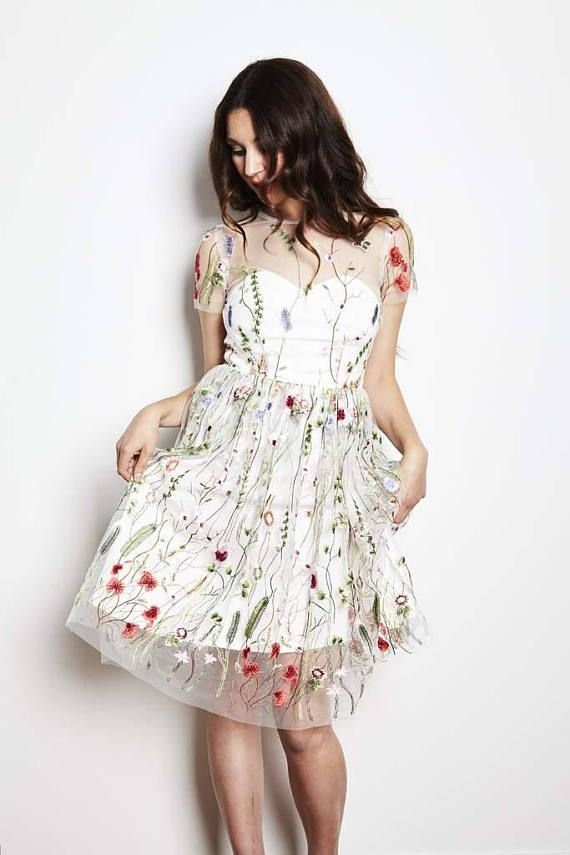 A stunning embroidered version of our Markova dress with a floral embroidered tulle overlaid onto a sateen base. The bodice has a sweetheart lining that is flattering and flirty. Back bodice is sheer tulle with embroidery. Zipper up center back, the skirt overlay measures 25 from