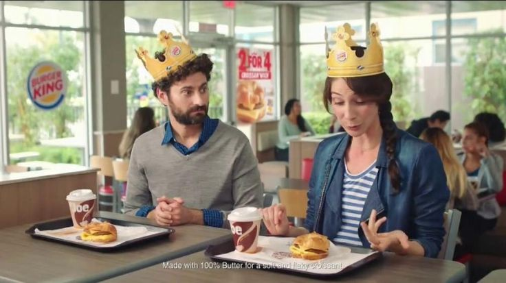 Before digging in, two Burger King customers wearing paper crowns explain what it is they ordered. The man declares that it's a Croissan'wich made with 100 percent real butter, but admits that the way the woman beside him said it with a thick French accent was a lot prettier.