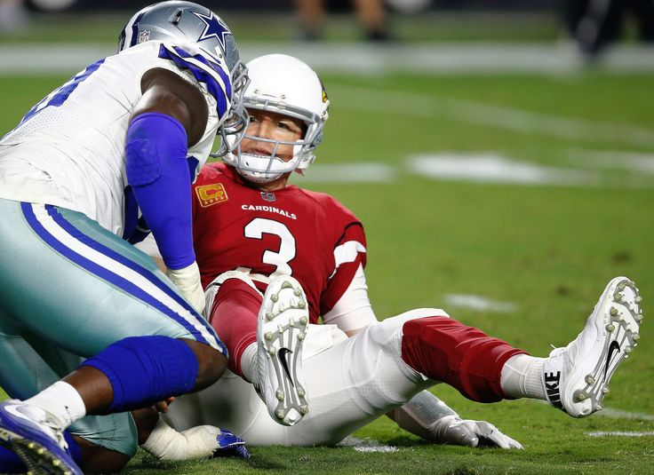 Arizona Cardinals quarterback Carson Palmer (3) looks at Dallas Cowboys defensive end Demarcus Lawrence after being sacked during the second half of an NFL ...