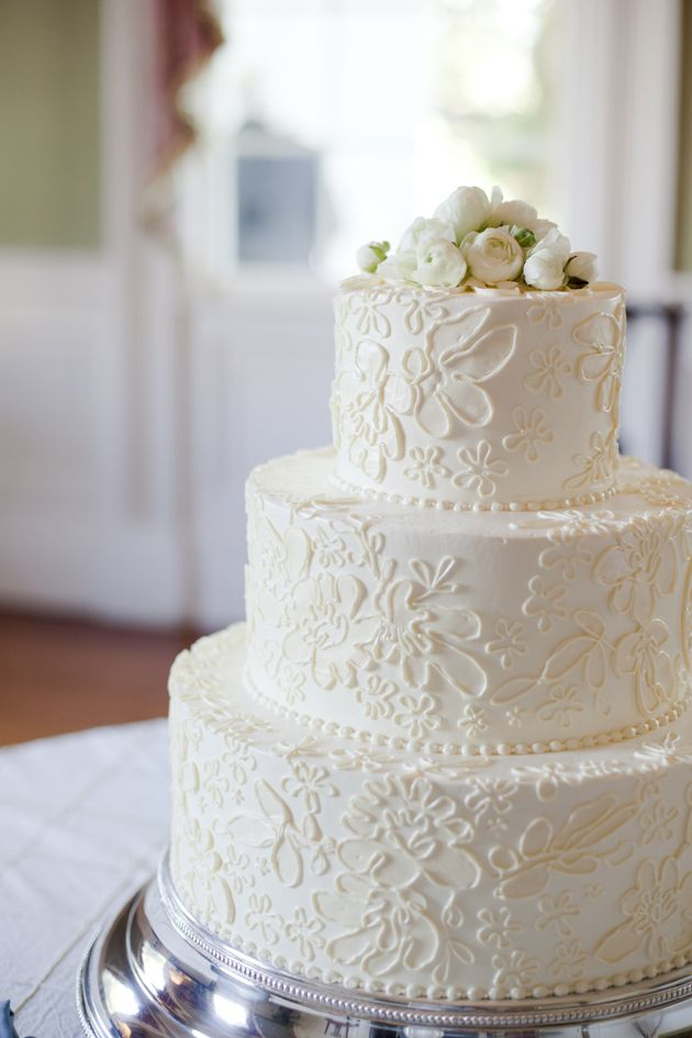 This buttercream-iced cake has a floral pattern that looks like a lace appliqué. Very pretty! And no fondant necessary.