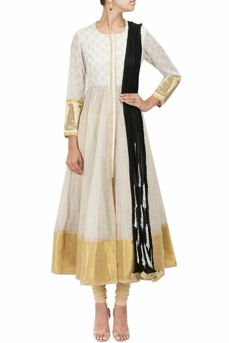 Off white kalidaar jacket with black dupatta and leggings BY VASAVI SHAH.