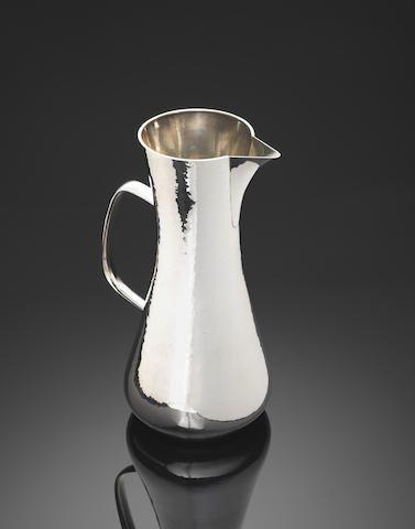 ROBERT WELCH: A silver water jug London 1978