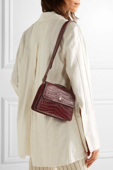 Burgundy croc-effect leather and suede  Snap-fastening front flap  Comes with dust bag Weighs approximately 1.1lbs/ 0.5kg Imported