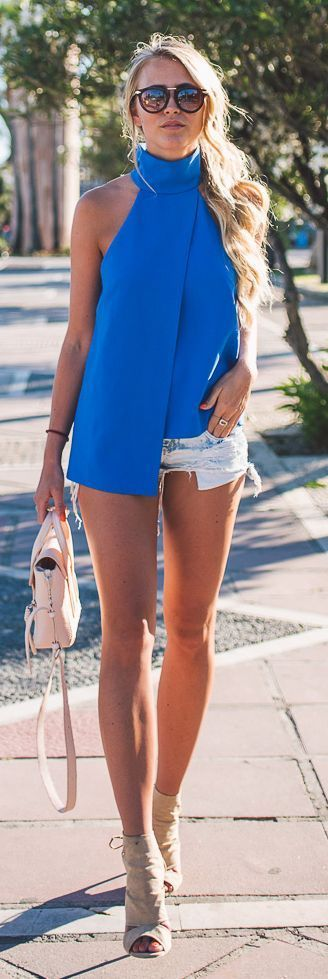 Too long top that is longer than your shorts. See the things you should not wear to the office >>> http://justbestylish.com/10-things-you-shouldnt-wear-to-the-office-in-summer/