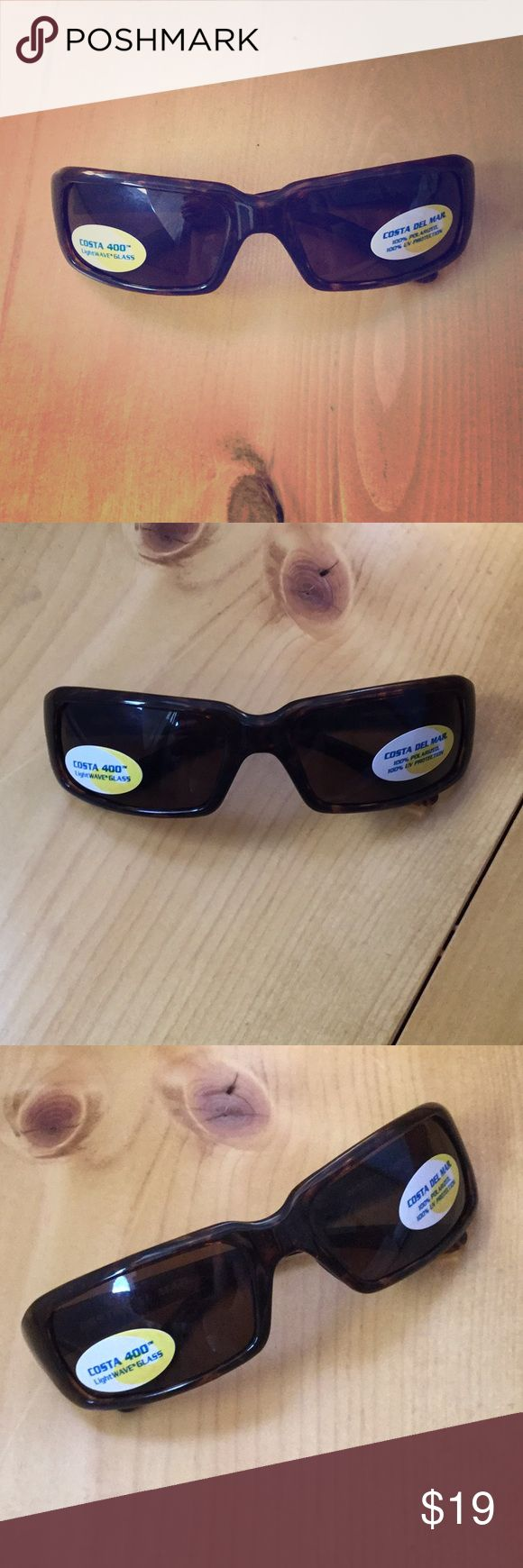 Costa Del Mar Sunglasses! These beauties have never been worn. They have all original stickers attached and they are in perfect condition. They do not come with the case. Perfect for any outdoor weather activities! Costa Del Mar Accessories Sunglasses