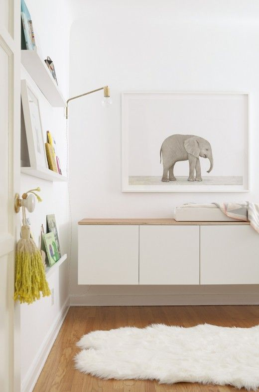 Such a serene & Scandi nursery... Cute elephant photo, lovely built in storage/change station and ombre tassel!