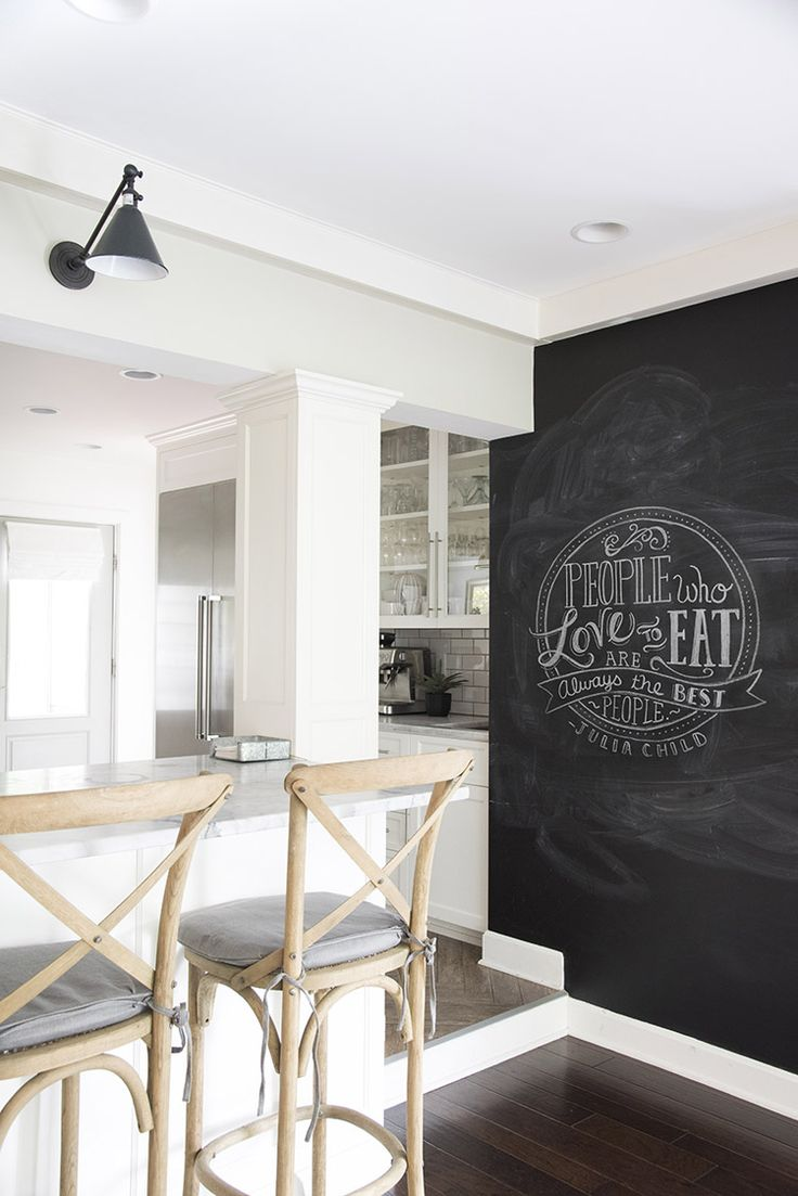 A Bright White Family-Friendly Kitchen with a chalkboard wall