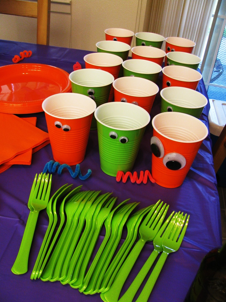 Eyes hot glued on cups for my sons monster themed first bday party