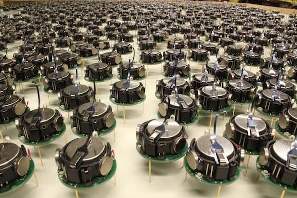 Here's a video of the largest group of swarmbots ever assembled. While using them to form shapes is interesting, its opening the door for far more sophisticated uses.