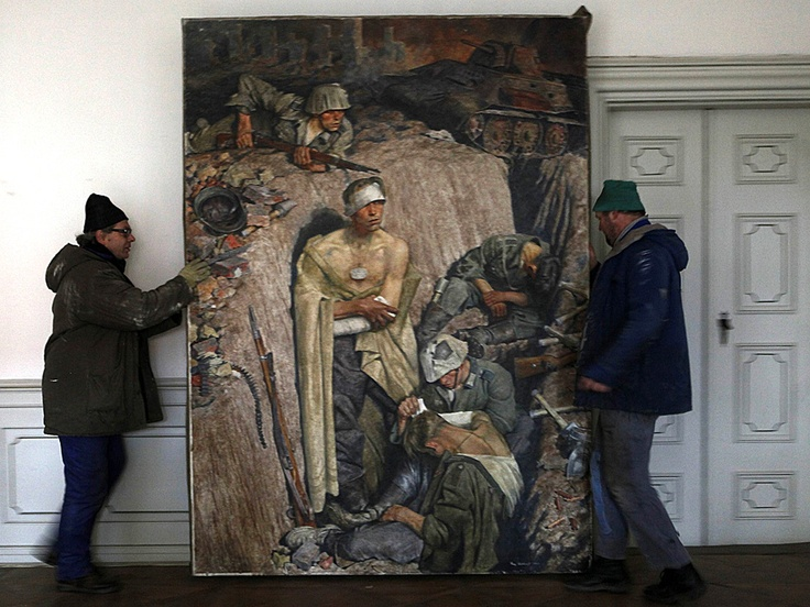 "Workers move a 1943 painting by German painter Franz Eichhorst titled, ""Reminiscence on Stalingrad"", a part of Adolf Hitler's private art collection, at the Doksany Monastery near Prague February 27, 2012. Sixteen paintings from this collection were recently found in the Czech Republic, but will not be publicly displayed"