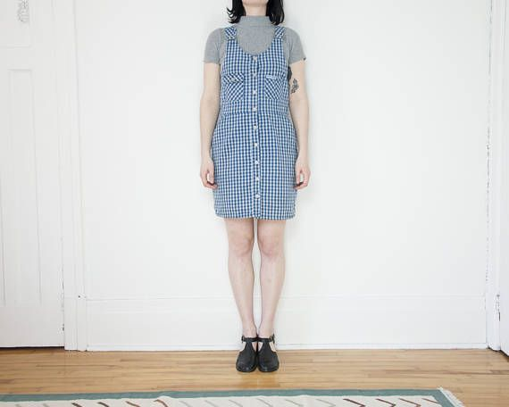 90s blue plaid jumper dress in really great vintage condition. Really beautiful medium weight fabric with adjustable straps and slash pockets. **Please note that there is a very small orange stain at the front of the dress on the waistband at the right side**  Brand: Point Zero Material: 100% cotton Made in: China Listed Size: 5 (fits like a size 8 or medium)  *model is 59 and wears a size 28/8/M*  For best fit, please compare the following measurements to a similar garment of your ...
