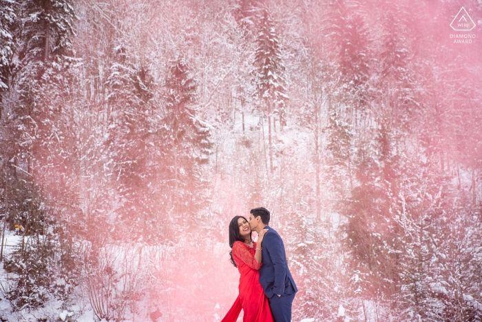 Interlaken Switzerland Pink Smoke Grenade Engagement Winter Portrait With Essex Wedd Prewedding Photography Engagement Photographer Best Wedding Photographers