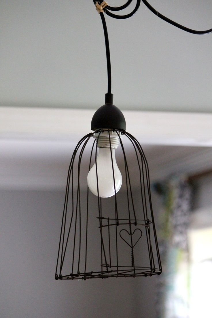 Love this little heart bird cage pendant light. Mommo design