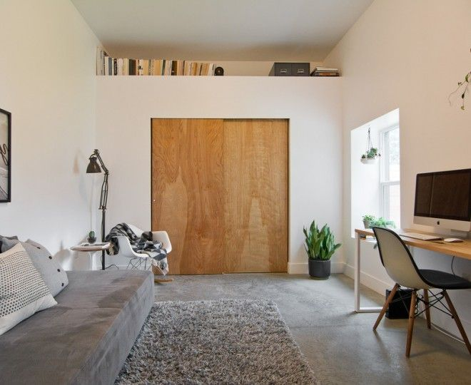 Chic Closet Doors Sliding  look Salt Lake City Midcentury Home Office Decorating ideas with  beige wall black and white photography bookcase ledge concrete floor gray shag rug gray