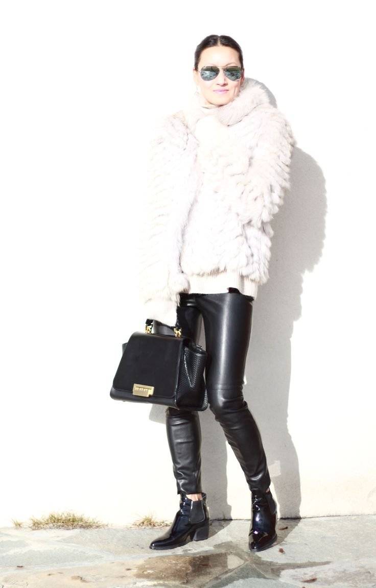 Shop this look on Lookastic:  http://lookastic.com/women/looks/sunglasses-turtleneck-skinny-pants-chelsea-boots-fur-jacket-satchel-bag/8305  — Grey Sunglasses  — White Wool Turtleneck  — Black Leather Skinny Pants  — Black Leather Chelsea Boots  — White Fur Jacket  — Black Suede Satchel Bag