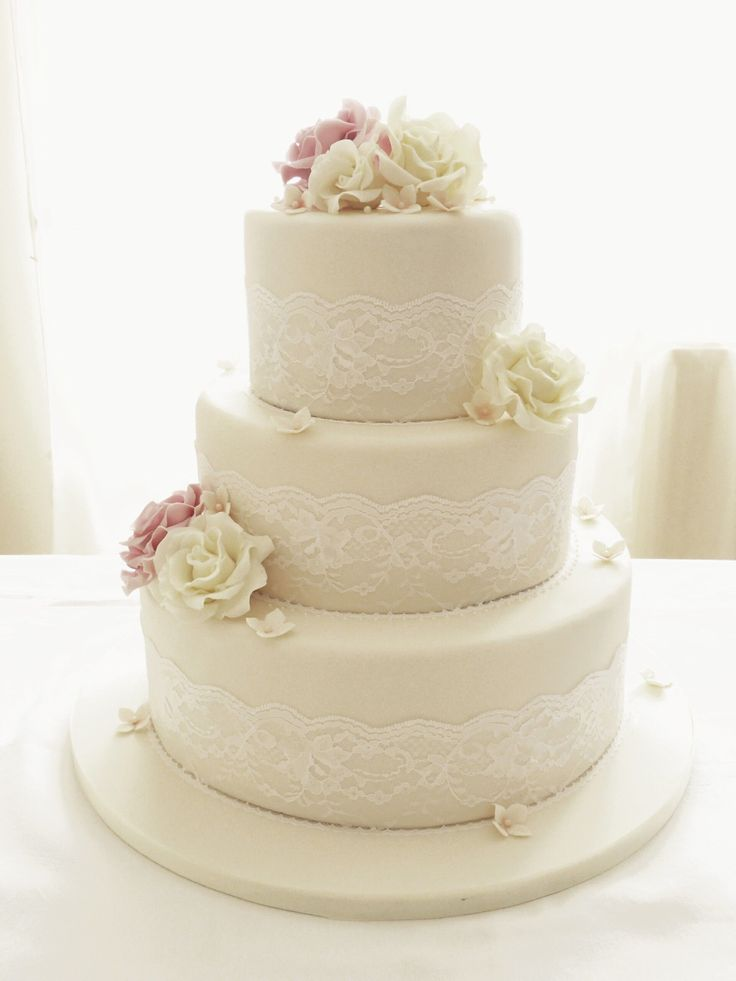 Round Wedding Cakes - Ivory roses and lace three tier wedding cake