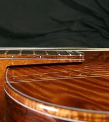 Mcpherson Guitar. One of the details that makes it sound so good is the fret board doesn't touch the top of the guitar, letting the sound vibrate freely.