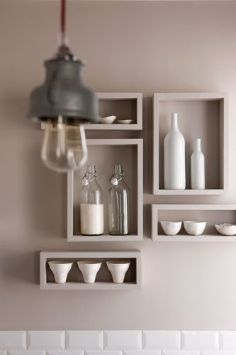 shelf painted same as wall with monochromatic accessories, (Do this with the glass from Chris in my kitchen)