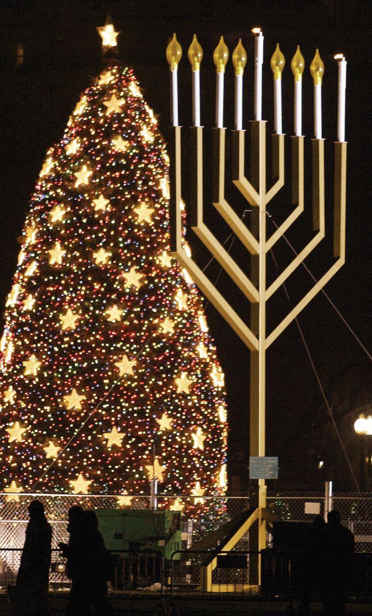A Christmas tree and Hanukkah menorah sharing space in Washington, D.C., Credit: © Tim Sloan—AFP/Getty Images
