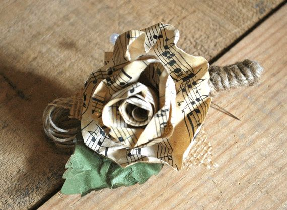 Old sheet music Boutonniere: My mom made my grooms boutonniere using sheet music with a guitar accent.