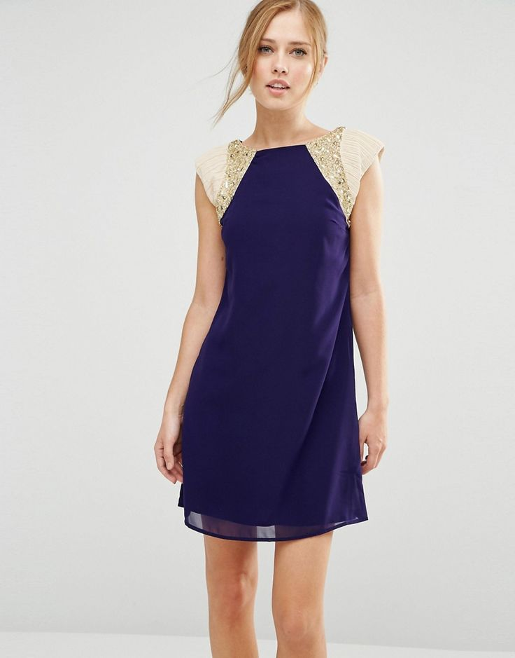 Buy it now. Little Mistress Shift Dress With Metallic Sleeves - Navy. Dress by Little Mistress, Lined chiffon, High neckline, Beaded raglan sleeves, Shift style, Zip-back fastening, Regular fit - true to size, Hand wash, 100% Polyester, Our model wears a UK 8/EU 36/US 4 and is 175cm/5'9 tall. ABOUT LITTLE MISTRESS Rapidly developing a cult fan following, coveted new label Little Mistress brings forth a collection of feminine and super-flattering designs. Adapting hot catwalk trends into…
