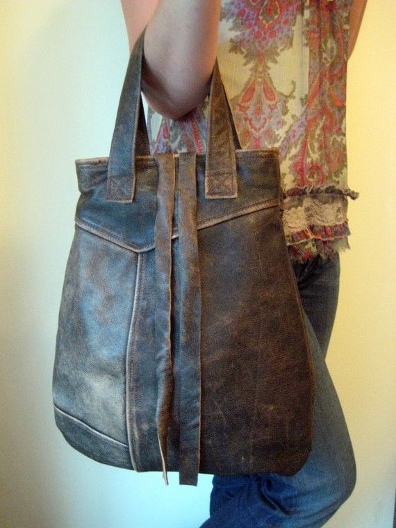 This bag was made from a recycled leather garment. I love the worn, dark brown leather. The leather is thick and sturdy... and quite beautiful. There