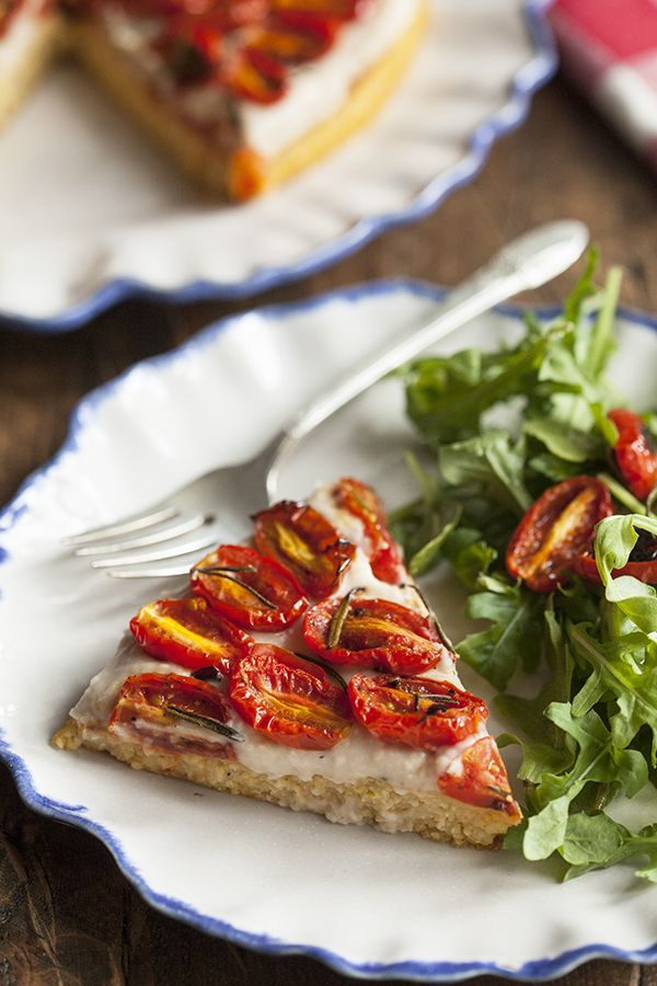 Polenta Tart with Garlicky White Bean Spread and Roasted Cherry Tomatoes. #vegan #glutenfree #soyfree
