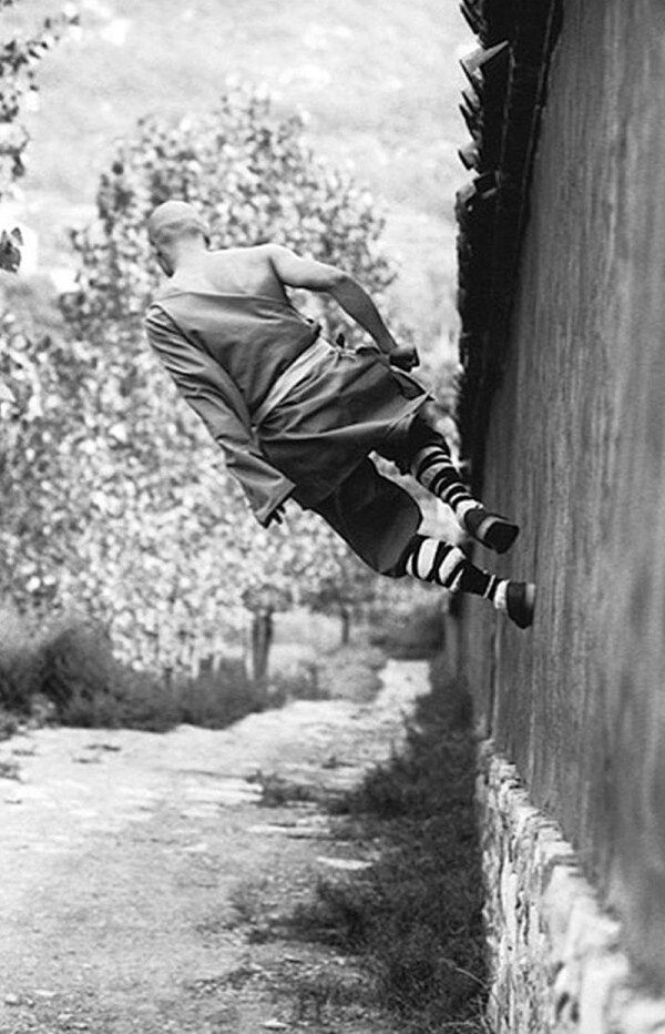 """Shaolin Monks strive for quiescence of body, mind and intention.  Yes, he is walking """"sideways"""" on a wall.  Source: http://memolition.com/2014/01/30/shaolin-monks-training-18-pictures/"""
