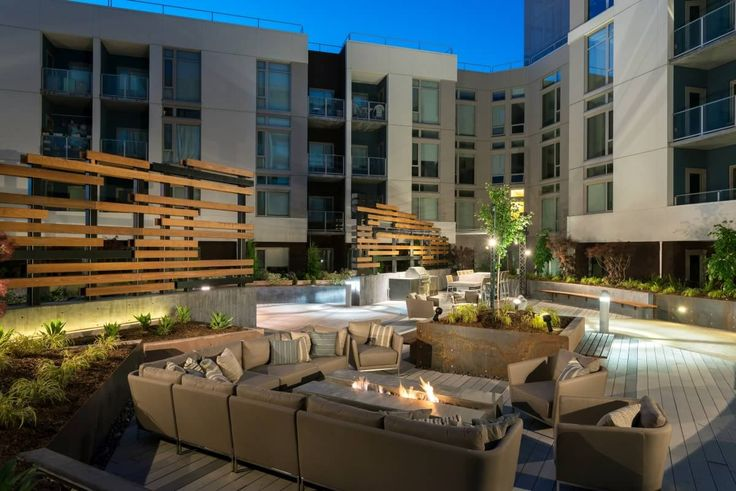 Outdoor Lounge with screen wall and fire pit at Channel ...