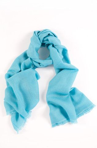 Aqua Blue 100% Cashmere Shawl:  A serene expression of youth and beauty. Made from the highest quality cashmere, this bright turquoise blue shawl is magnificently soft and gentle to the touch.  Features include:      100% Cashmere      Handwoven with French cut ends      Size - 75 x 195 cm      Weight - 175g  Our shawls are authenticated with a Chyangra Pashmina logo. This hallmark guarantees that the highest quality and most genuine cashmere is used in our product.