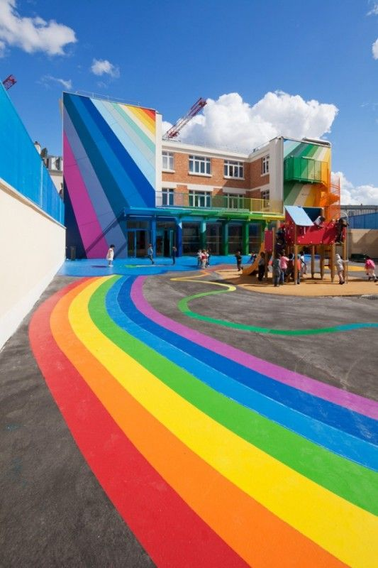 the Ecole Maternelle Pajol is using color & design to stimulate and inspire students.  The renovation, by Palatre et Leclere Architectes, was comprised of changes to both the indoor and outdoor spaces of the school.  The façade of the building is complete with a full spectrum of colorful rays, creating a focal point out of the multi-level courtyard.  Along with the blacktop mural and the vibrant portico, the courtyard of the school was designed as a symbol of optimism within the urban area.Primary Schools, Building, Maternel Pajol, Rainbows Colors, Paris France, Places, Kindergarten, Architecture Offices, Design
