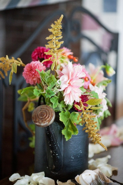Love the idea of using old watering cans as vases