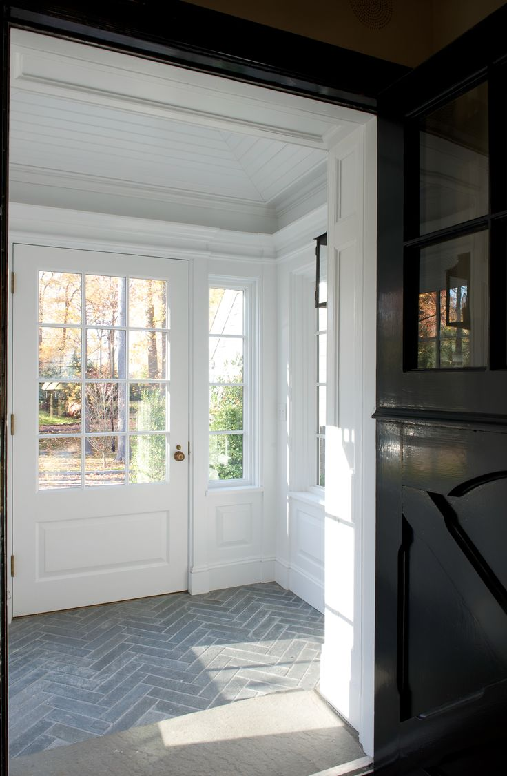 Herringbone tile, black Dutch door | Brooks & Falotico