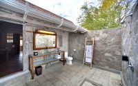 Charming open bathroom offering all modern amenities in a closer-to-nature way.